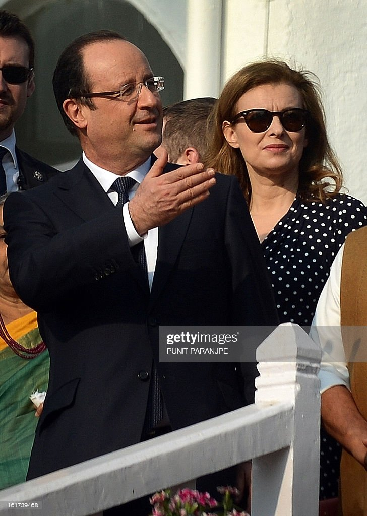 France's President Francois Hollande (L) gestures as his partner Valerie Trierweiler looks on during their visit at the residence of the Governor of the western Indian state of Maharashtra in Mumbai on February 15, 2013. French President Francois Hollande wrapped up his two-day trip to India on Friday with a call for more investment and trade between the countries as he met with business leaders.
