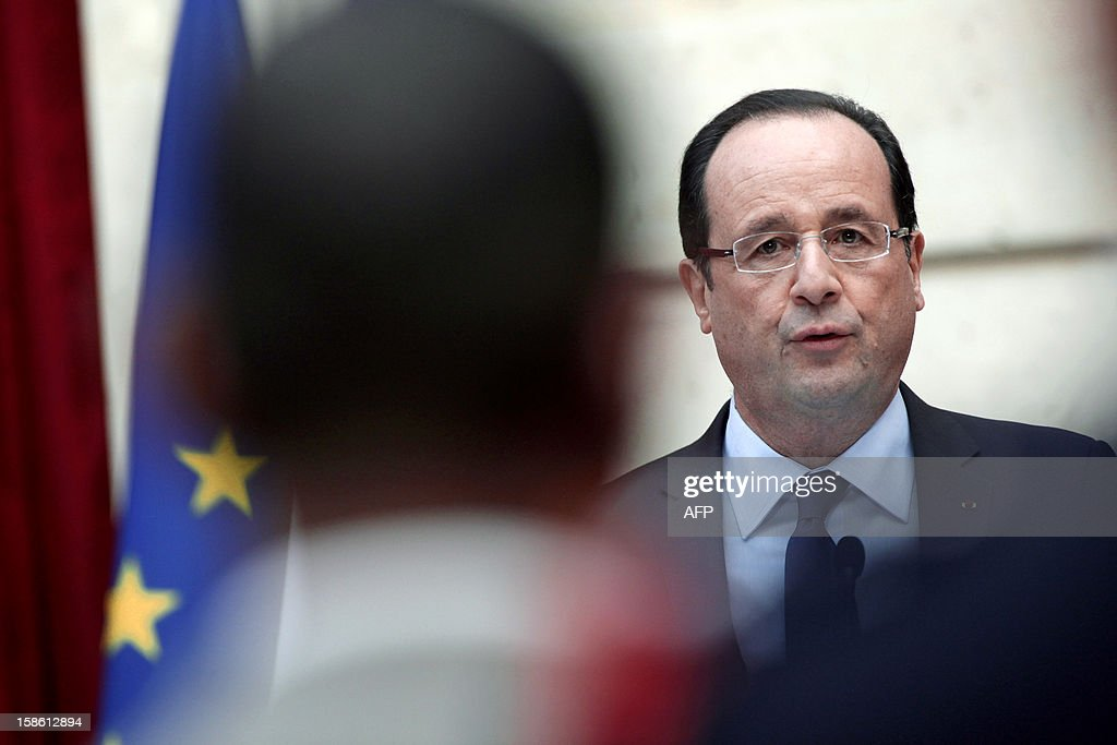 France's President Francois Hollande gives a speech during a ceremony in honour of French troops that served in Afghanistan, on December 21, 2012 at the Elysee Palace, in Paris. Hollande has declared 'mission accomplished' for French combat troops who returned home recently from Afghanistan. France still has 1,500 troops in Afghanistan repatriating equipment or working in roles like providing medical care or helping run Kabul's airport. Hollande said the numbers will decline to 500 by mid-2013. AFP PHOTO POOL THIBAULT CAMUS