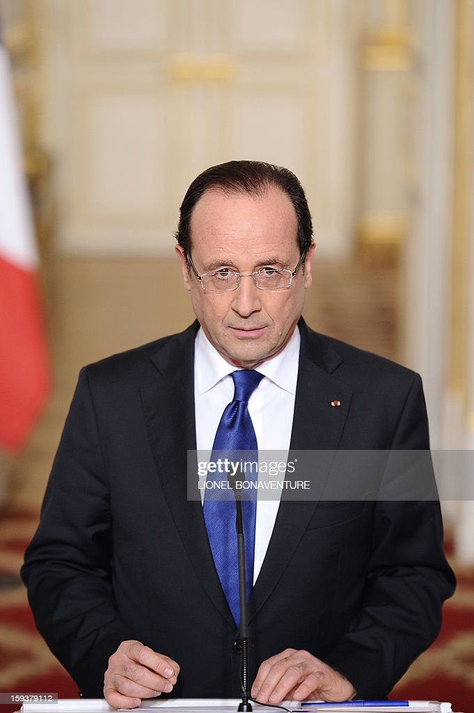 France's president Francois Hollande gives a speech focused on the Malian situation, on January 12, 2013 at the Elysee presidential palace in Paris. Backed by French air power, Malian troops on January 11, 2013 unleashed an offensive against Islamist rebels who, having seized control of the north of the country in March last year, were threatening to push south. France has asked the United Nations to 'accelerate' implementation of a resolution that enables the deployment of an international force to Mali. AFP PHOTO / POOL / LIONEL BONAVENTURE
