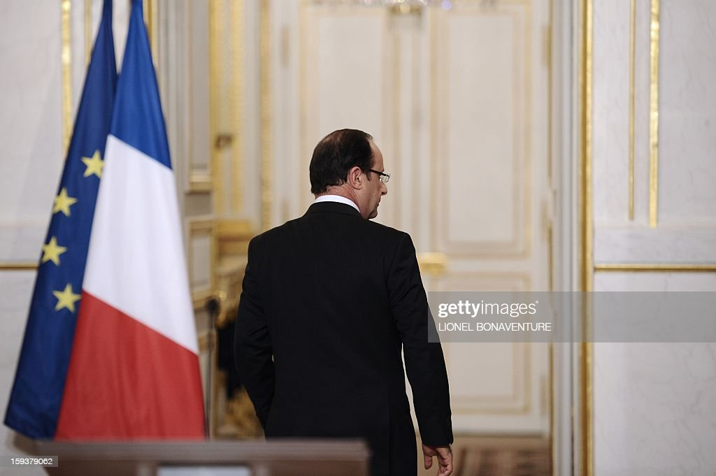 France's president Francois Hollande leaves after a speech focused on the Malian situation, on January 12, 2013 at the Elysee presidential palace in Paris. Backed by French air power, Malian troops on January 11, 2013 unleashed an offensive against Islamist rebels who, having seized control of the north of the country in March last year, were threatening to push south. France has asked the United Nations to 'accelerate' implementation of a resolution that enables the deployment of an international force to Mali. AFP PHOTO / POOL / LIONEL BONAVENTURE