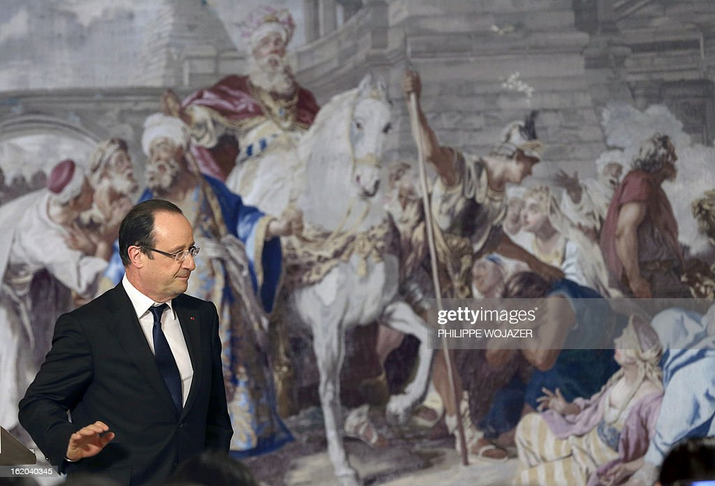 France's president Francois Hollande leaves after addressing representatives of France's Chinese community associations on February 18, 2013 at the Elysee Presidential Palace in Paris, to mark the Chinese Lunar New Year. AFP PHOTO / POOL / PHILIPPE WOJAZER