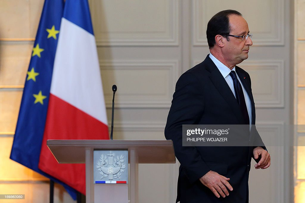 France's President Francois Hollande leaves after delivering a statment on the situation in Mali at the Elysee Palace in Paris, on January 11, 2013. French troops are actively supporting an offensive by Mali government forces against Islamists who control the north of the country, President Francois Hollande announced.