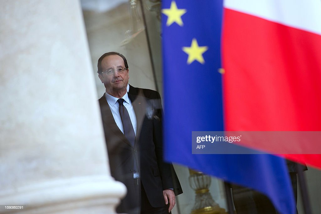 France's President Francois Hollande poses after a meeting with Indian Minister for External Affairs on January 11, 2013 at the Elysee presidential palace in Paris.
