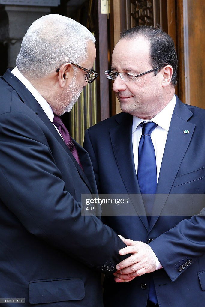France's President Francois Hollande (R) shakes hands with Morocco's Prime minister Abdelilah Benkirane prior to a meeting at the Royal guests house in Rabat, on April 4, 2013. Hollande is on a two-day visit in Morocco. POOL