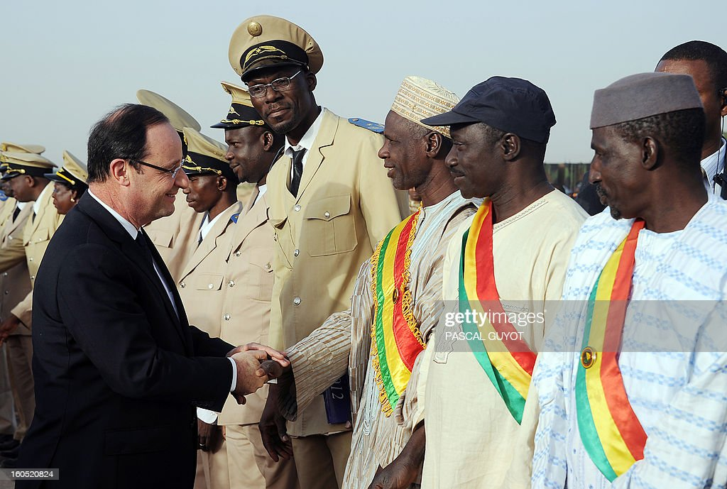 France's President Francois Hollande (L) shakes hands with Prefects of Mopti upon his arrival at Sevare, near Mopti, on February 2, 2013. President Francois Hollande visits Mali as French-led troops work to secure the last Islamist stronghold in the north after a lightning offensive against the extremists. Hollande will head to Timbucktu and Bamako.