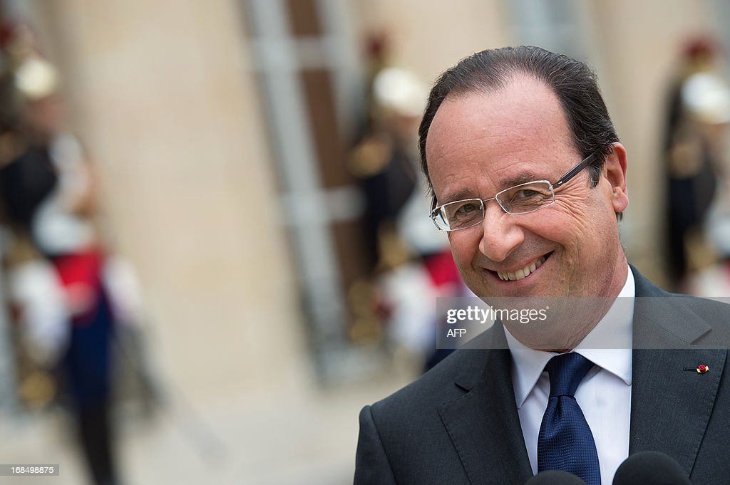 France's President Francois Hollande smiles as he speaks to journalists following a meeting with Niger's President after a meeting at the Elysee presidential palace in Paris on May 10, 2013. AFP PHOTO / BERTRAND LANGLOIS
