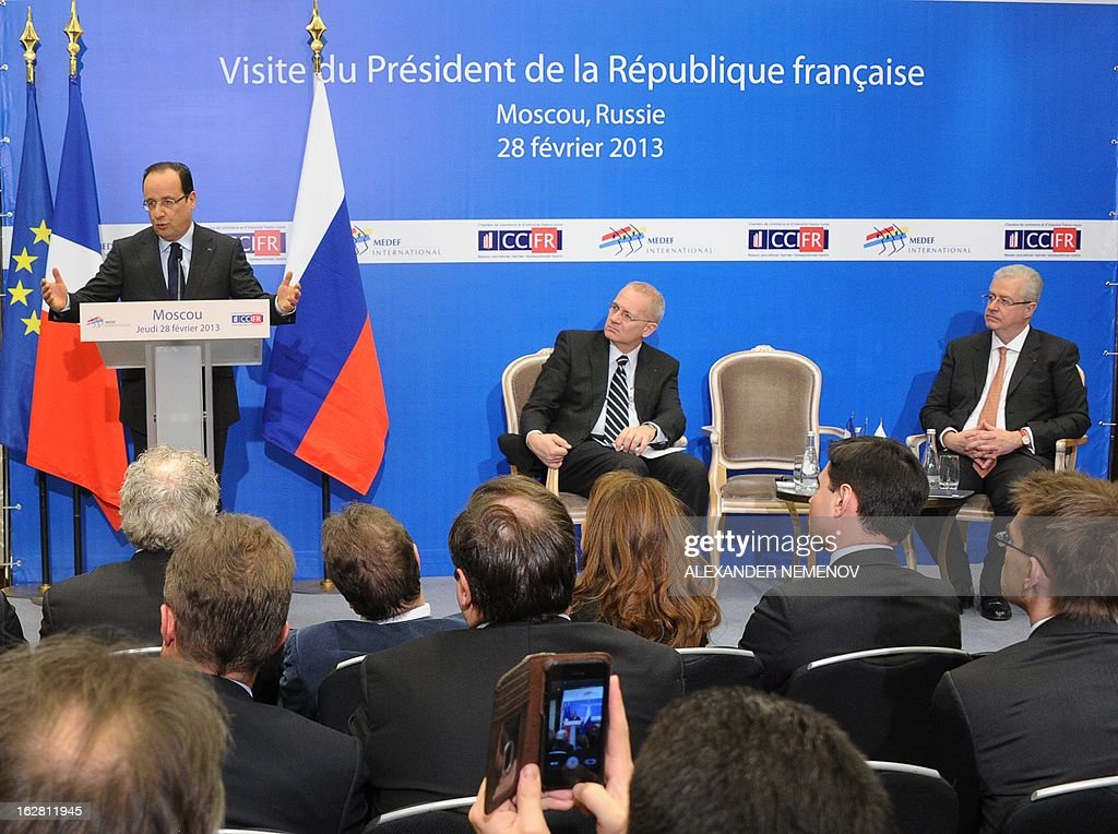 France's President Francois Hollande (L) speaks at a meeting with Russian and French businessmen at an economic forum in Moscow on February 28, 2013, prior to a meeting with Russia's President Vladimir Putin at the Kremlin. Hollande said today on a visit to Moscow that he believed it would be possible to come to a political decision on the Syrian conflict in the coming weeks.