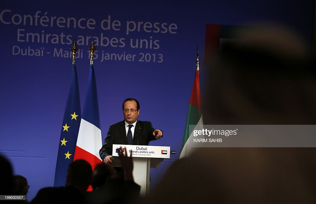 France's President Francois Hollande speaks during a press conference at the World Future Energy Summit (WFES) in Dubai on January 15, 2013. AFP PHOTO/KARIM SAHIB