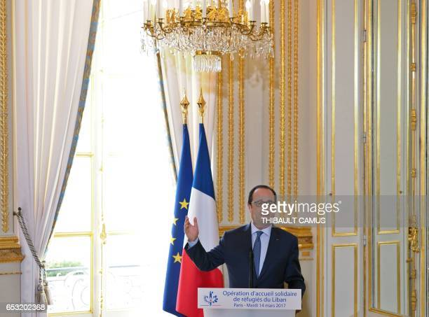 France's President Francois Hollande speaks during the signing of a protocol to welcome refugees coming from Lebanese camps at the Elysee Palace in...