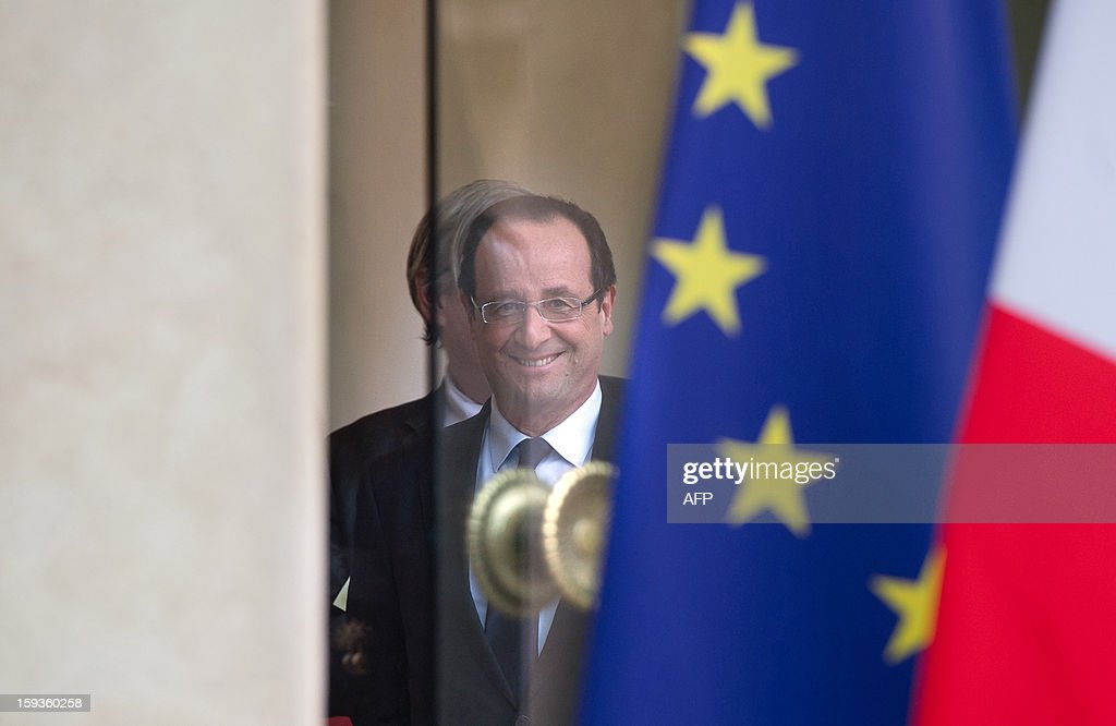 France's President Francois Hollande speaks with councellors after a meeting with Indian Minister for External Affairs on January 11, 2013 at the Elysee presidential palace in Paris.