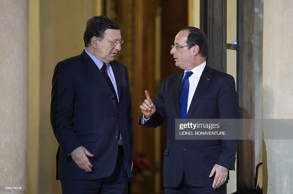 France's President Francois Hollande (R) speaks with EU Commission President Jose Manuel Barroso at the Elysee presidential palace on January 12, 2013 in Paris, before a meeting. Earlier, President Francois Hollande gives a speech focused on the Malian situation. Backed by French air power, Malian troops on January 11, 2013 unleashed an offensive against Islamist rebels who, having seized control of the north of the country in March last year, were threatening to push south. A French military pilot had been killed during the operation. AFP PHOTO / LIONEL BONAVENTURE