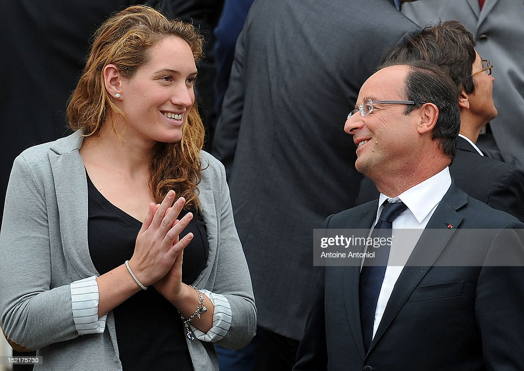 France's President Francois Hollande speaks with French Olympic Gold swimmer Camille Muffat at Elysee Palace on September 17 2012 in Paris France