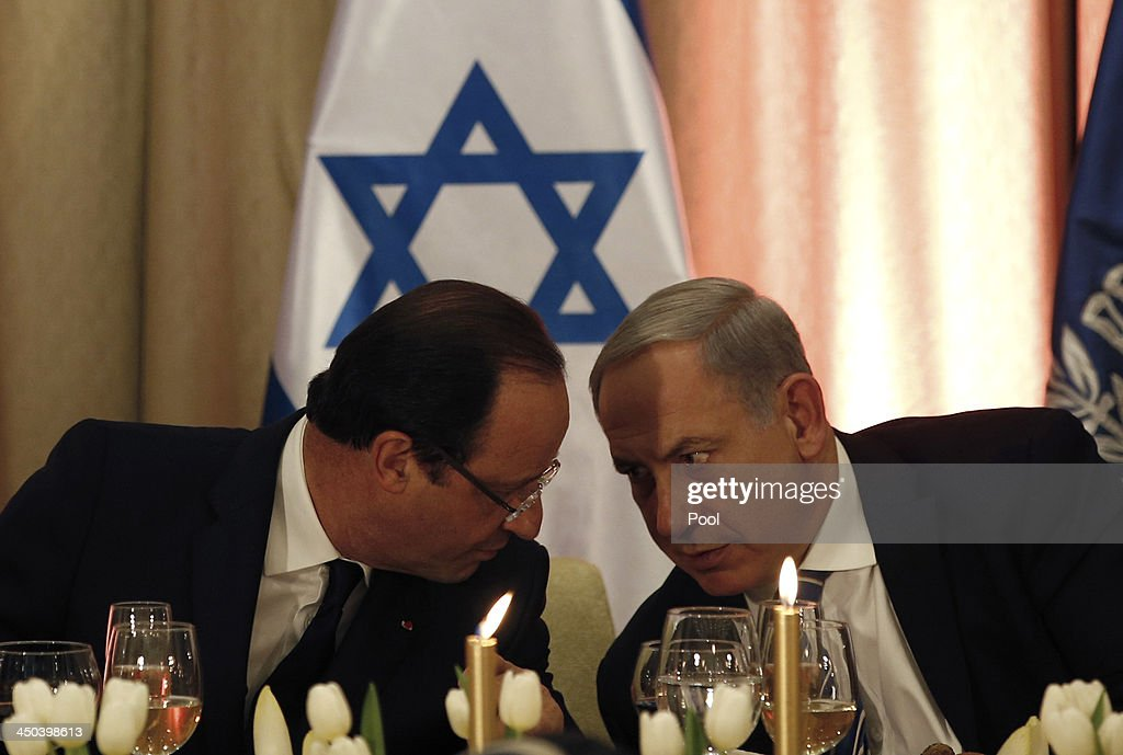 France's President Francois Hollande speaks with Israel's Prime Minister <a gi-track='captionPersonalityLinkClicked' href=/galleries/search?phrase=Benjamin+Netanyahu&family=editorial&specificpeople=118594 ng-click='$event.stopPropagation()'>Benjamin Netanyahu</a> at an official state dinner hosted by Israel's President Shimon Peres at his residence on November 18, 2013 in Jerusalem, Israel. President of France Francois Hollande is on a three day official visit to Israel and the West Bank.