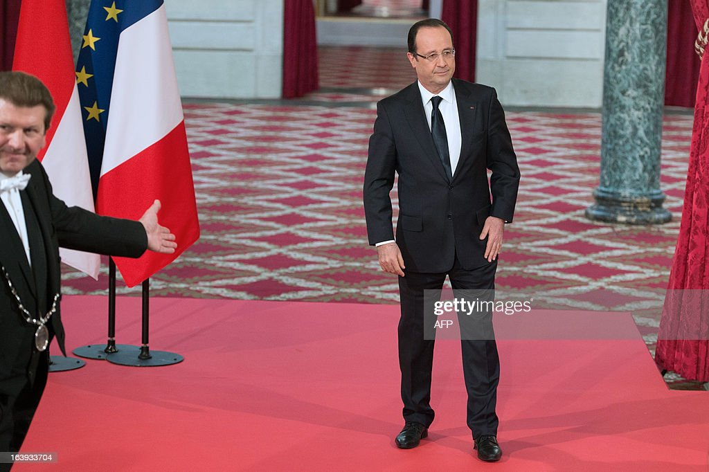 France's President Francois Hollande stands after European aerospace giant Airbus and Lion Air comapny have signed a contract on March 18, 2013 during a ceremony at the Elysee presidential palace in Paris. Airbus announced a record order worth 18.4 billion euros ($ 23.8 billion) from Indonesia's Lion Air for 234 medium-haul A320 jets. Lion Air, Indonesia's largest private carrier and one of the world's fastest growing airlines, is a new client for Airbus as it has previously been equipped almost exclusively by US rival Boeing.