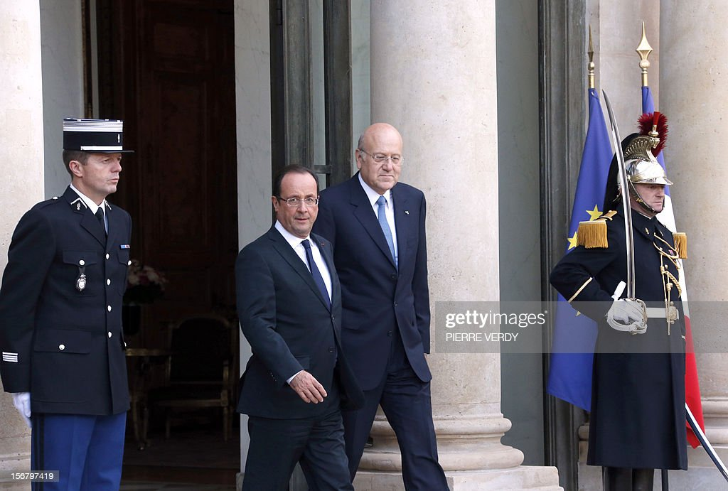 France's President Francois Hollande (L) stands by Lebanese Prime Minister Najib Mikati who leaves the Elysee presidential Palace in Paris after a meeting, on November 21, 2012.