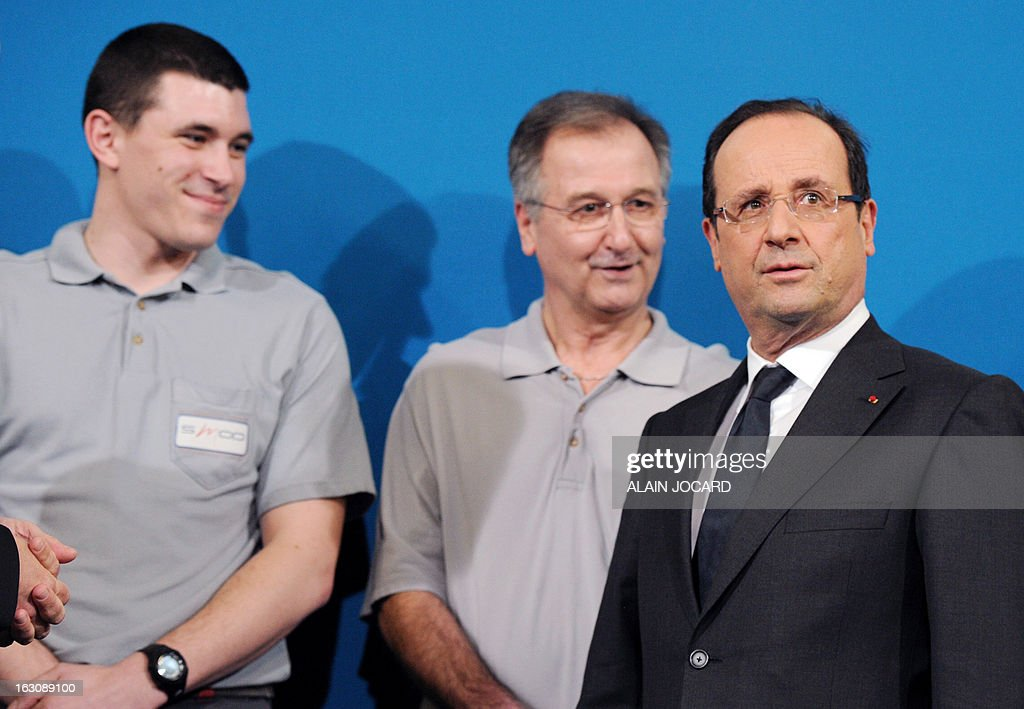 France's President Francois Hollande (R) takes part in a ceremony to sign new apprentice contracts in Blois, on March 4, 2013.