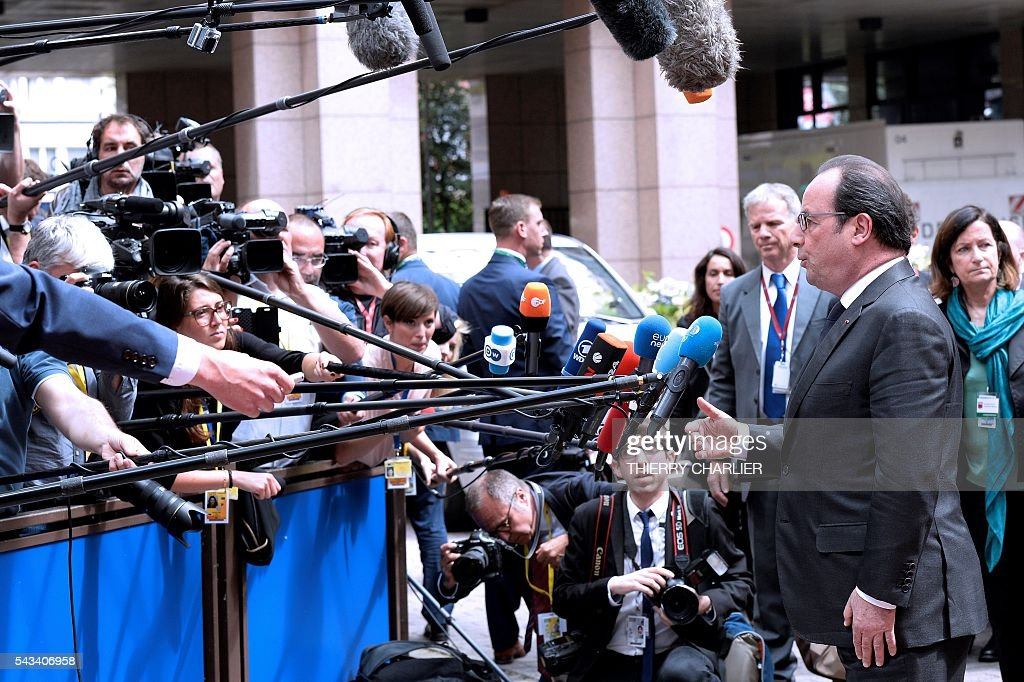 France's President Francois Hollande talks to the press as he arrives before an EU summit meeting on June 28, 2016 at the European Union headquarters in Brussels. / AFP / THIERRY