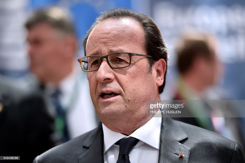 France's President Francois Hollande talks to the press as he arrives before an EU summit meeting on June 28, 2016 at the European Union headquarters in Brussels. / AFP / PHILIPPE