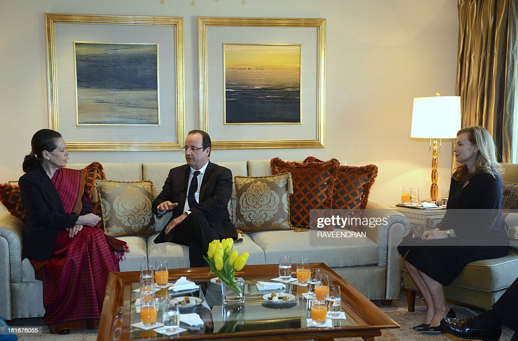 France's President Francois Hollande (C) talks with Chairperson of the Congress-led UPA government, Sonia Gandhi (L) as his partner Valerie Trierweiler looks on during a meeting in New Delhi on February 14, 2013. French President Francois Hollande embarked on a fresh push to clinch a USD 12-billion sale of Rafale fighter jets as he held talks in India on his first visit to Asia since taking office. The Socialist president was accompanied by a high-powered delegation of five ministers including Foreign Minister Laurent Fabius and Defence Minister Jean-Yves Le Drian and the chiefs of more than 60 top French companies.