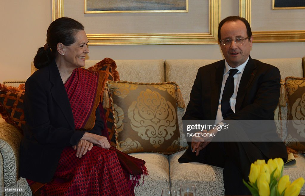 France's President Francois Hollande (R) talks with Chairperson of the Congress-led UPA government, Sonia Gandhi during a meeting in New Delhi on February 14, 2013. French President Francois Hollande embarked on a fresh push to clinch a USD 12-billion sale of Rafale fighter jets as he held talks in India on his first visit to Asia since taking office. The Socialist president was accompanied by a high-powered delegation of five ministers including Foreign Minister Laurent Fabius and Defence Minister Jean-Yves Le Drian and the chiefs of more than 60 top French companies.