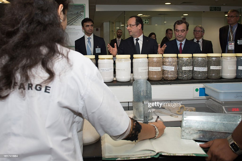 France's President Francois Hollande (C) visits a Lafarge construction development lab in Mumbai on February 15, 2013 during a two-day state visit to India. French President Francois Hollande wrapped up his two-day trip to India on Friday with a call for more investment and trade between the countries as he met with business leaders.