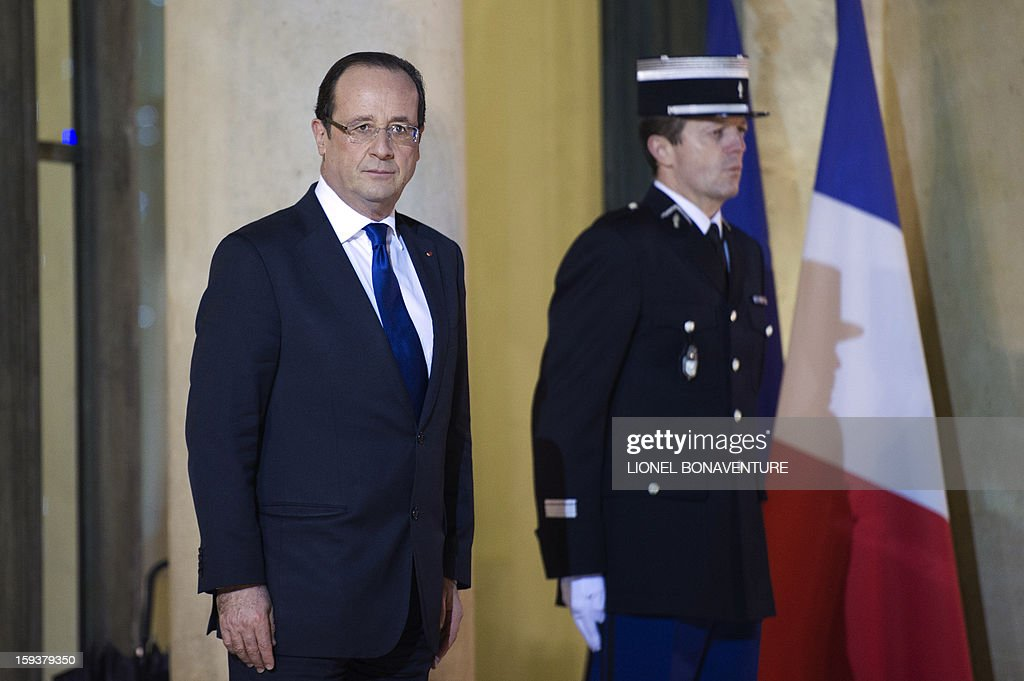 France's President Francois Hollande waits for EU Commission President at the Elysee presidential palace on January 12, 2013 in Paris, before a meeting. Earlier, President Francois Hollande gives a speech focused on the Malian situation. Backed by French air power, Malian troops on January 11, 2013 unleashed an offensive against Islamist rebels who, having seized control of the north of the country in March last year, were threatening to push south. A French military pilot had been killed during the operation.