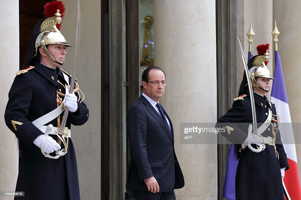 France's President Francois Hollande waits for the arrival of Indian Foreign Minister prior to a meeting at the Elysee presidential palace in Paris on January 11, 2013. India and French group Areva are close to agreement on a contract for Areva to build a nuclear power station on the west coast of India, Indian Foreign Minister Salman Khurshid said in a newspaper interview on Friday. AFP PHOTO BERTRAND LANGLOIS
