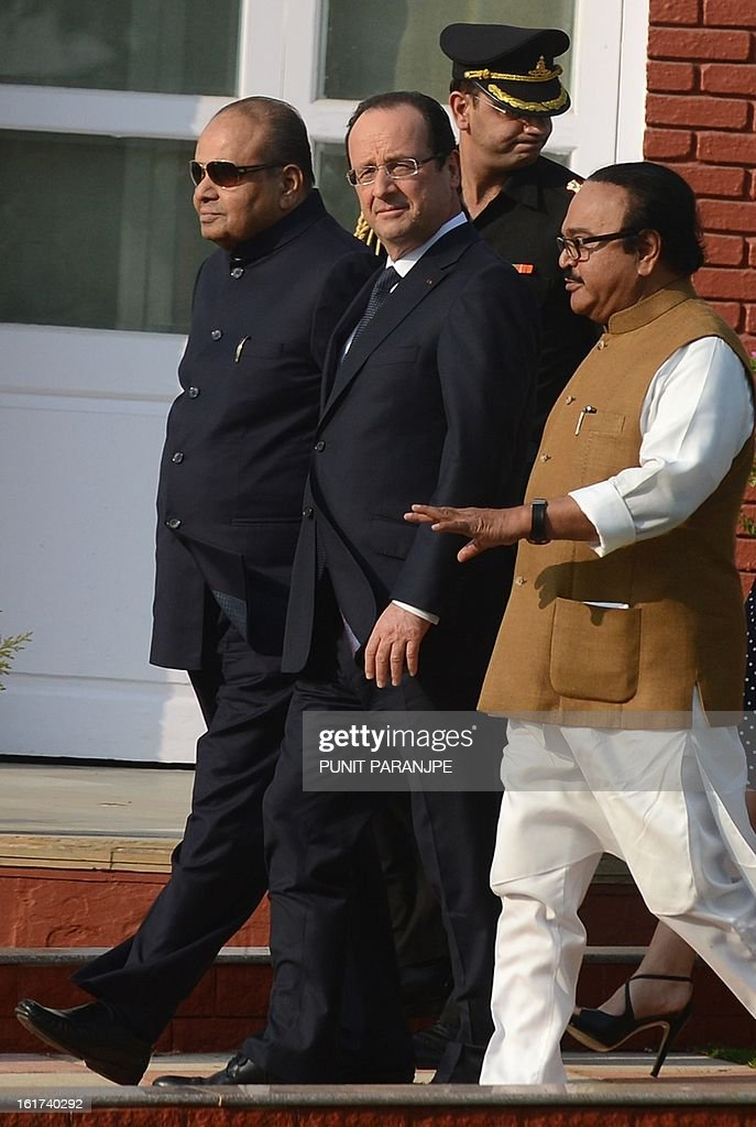 France's President Francois Hollande (C) walks with Governor of Maharashtra state K. Sankaranarayanan (L) and minister Chagan Bhujbal at the residence of the Governor in Mumbai on February 15, 2013. French President Francois Hollande wrapped up his two-day trip to India on Friday with a call for more investment and trade between the countries as he met with business leaders.