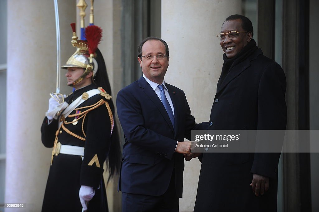 France's President Francois Hollande (L) welcomes Chad's counterpart Idriss Deby Itno for the Peace And Safety In Africa Summit at Elysee Palace on December 6, 2013 in Paris, France.