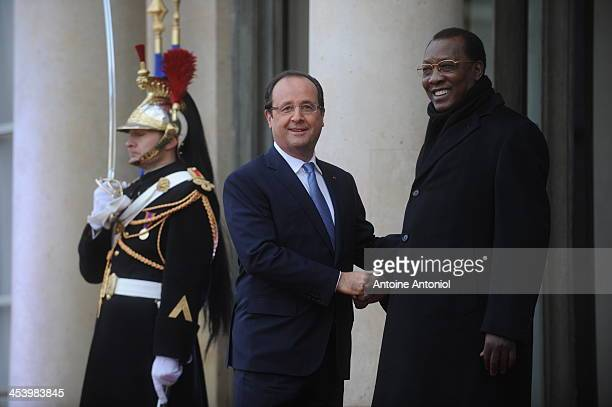 France's President Francois Hollande welcomes Chad's counterpart Idriss Deby Itno for the Peace And Safety In Africa Summit at Elysee Palace on...