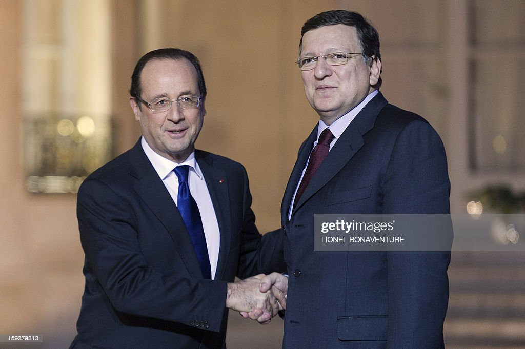 France's President Francois Hollande (L) welcomes EU Commission President Jose Manuel Barroso at the Elysee presidential palace on January 12, 2013 in Paris, before a meeting. Earlier, President Francois Hollande gives a speech focused on the Malian situation. Backed by French air power, Malian troops on January 11, 2013 unleashed an offensive against Islamist rebels who, having seized control of the north of the country in March last year, were threatening to push south. A French military pilot had been killed during the operation. AFP PHOTO / LIONEL BONAVENTURE