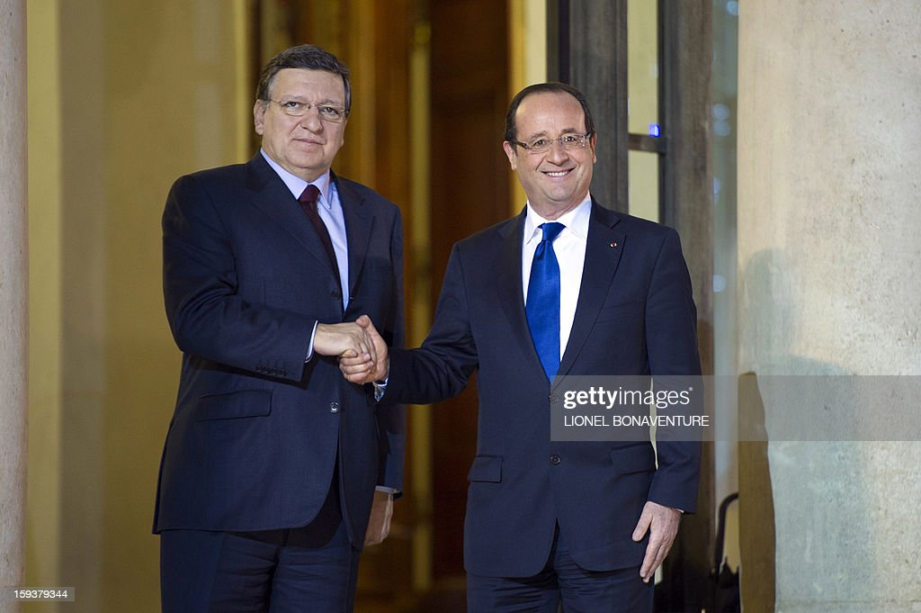 France's President Francois Hollande (R) welcomes EU Commission President Jose Manuel Barroso at the Elysee presidential palace on January 12, 2013 in Paris, before a meeting. Earlier, President Francois Hollande gives a speech focused on the Malian situation. Backed by French air power, Malian troops on January 11, 2013 unleashed an offensive against Islamist rebels who, having seized control of the north of the country in March last year, were threatening to push south. A French military pilot had been killed during the operation. AFP PHOTO / LIONEL BONAVENTURE
