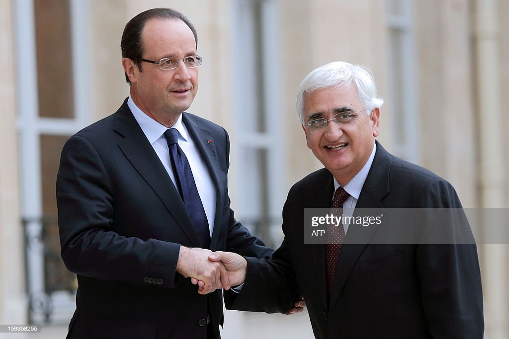 France's President Francois Hollande (L) welcomes Indian Foreign Minister Salman Khurshid at the Elysee presidential palace in Paris on January 11, 2013. India and French group Areva are close to agreement on a contract for Areva to build a nuclear power station on the west coast of India, Indian Foreign Minister Salman Khurshid said in a newspaper interview on Friday. AFP PHOTO BERTRAND LANGLOIS