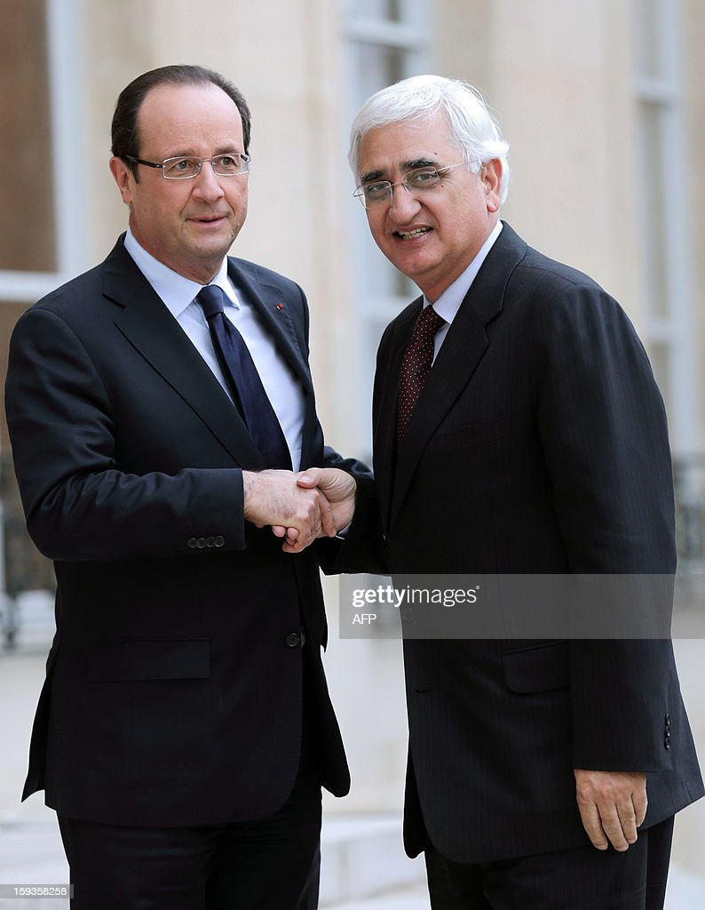 France's President Francois Hollande (L) welcomes Indian Foreign Minister Salman Khurshid at the Elysee presidential palace in Paris on January 11, 2013. India and French group Areva are close to agreement on a contract for Areva to build a nuclear power station on the west coast of India, Indian Foreign Minister Salman Khurshid said in a newspaper interview on Friday.