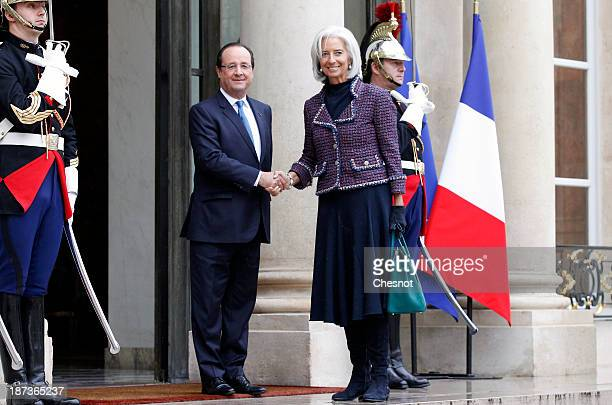 France's President Francois Hollande welcomes International Monetary Fund Managing Director Christine Lagarde prior to a meeting at the Elysee...