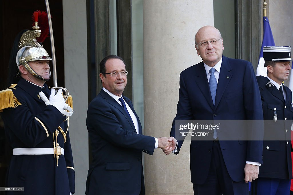 France's President Francois Hollande (L) welcomes Lebanese Prime Minister Najib Mikati prior to a meeting on November 21, 2012 at the Elysee Palace in Paris.
