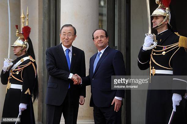 France's President Francois Hollande welcomes United Nations' general secretary BanKi moon for the Peace And Safety In Africa Summit at Elysee Palace...