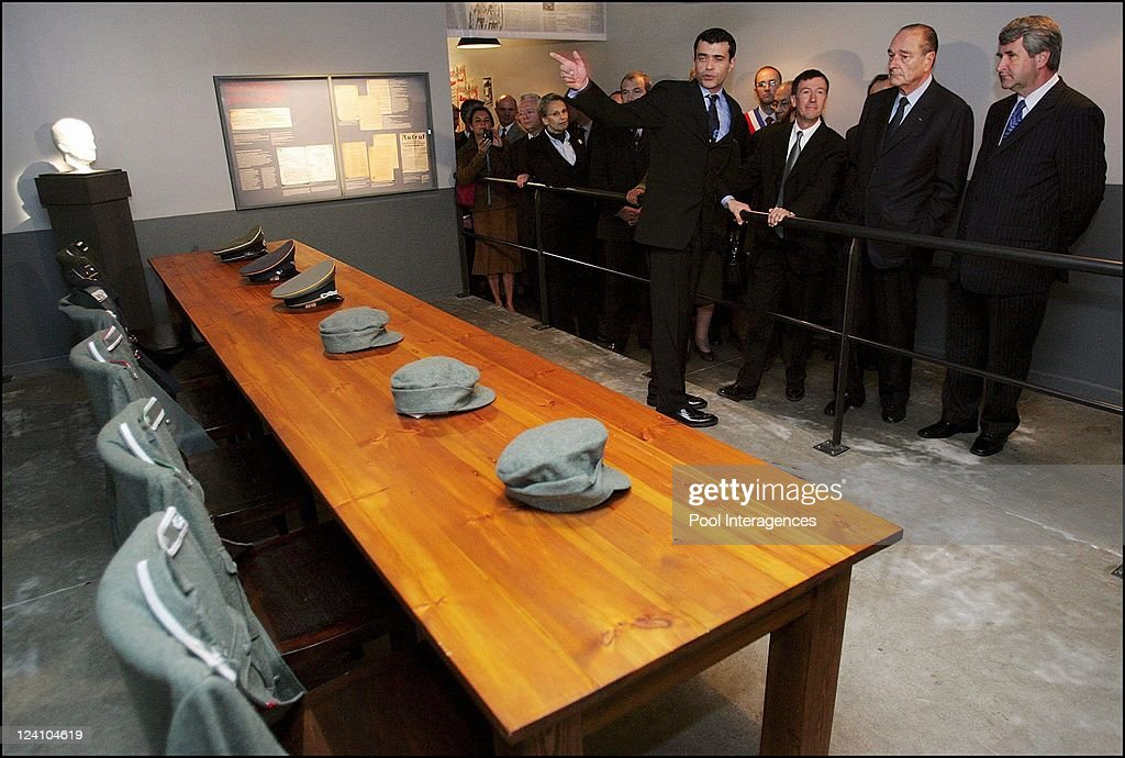 France's President Jacques Chirac looks at documents as he visits the Struthof-Natzweiler WWII concentration camp In France On November 03, 2005- President du Conseil General du Bas-Rhin, Philippe Richet.
