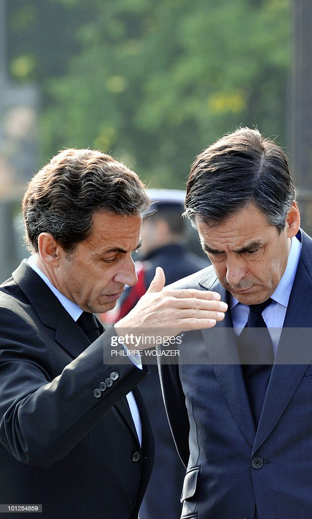 France's President Nicolas Sarkozy (L) chats with France's Prime Minister Francois Fillon at the end of a ceremony marking the 65th anniversary of the Allied victory over Nazi Germany in World War II, in Paris on May 8, 2010.