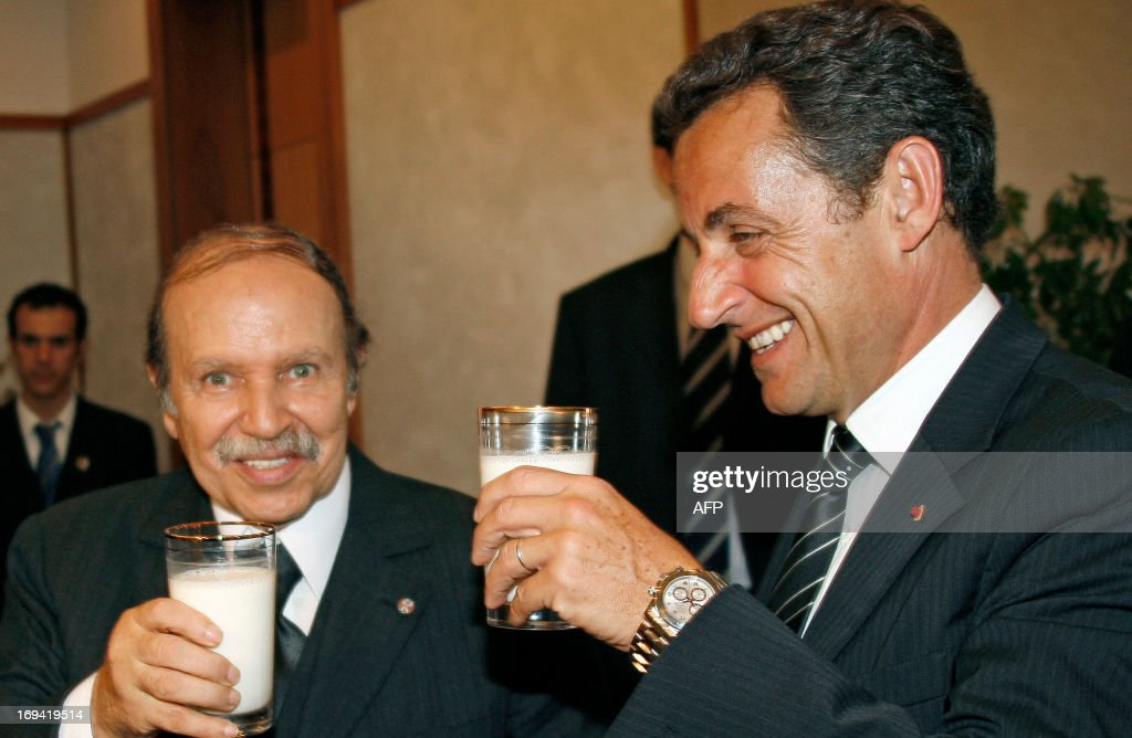 France's President Nicolas Sarkozy (R) is welcomed by Algerian President Abdelaziz Bouteflika in Algiers during a two-day official trip in Algeria and Tunisia, 10 July 2007.