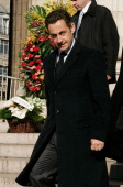 France's president Nicolas Sarkozy leaves the Madeleine Church in Paris after attending French crooner Henri Salvador's funeral ceremony on February...