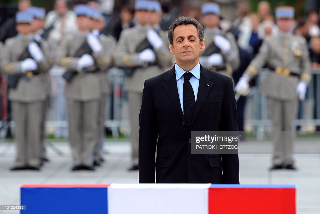 France's President Nicolas Sarkozy pays his respects after laying a wreath in front a stele during a ceremony marking the 65th anniversary of the Allied victory over Nazi Germany in World War II, in Colmar, eastern France, on May 8, 2010. French General de Lattre de Tassigny led the French first Army who freed Colmar, on February 2, 1945.
