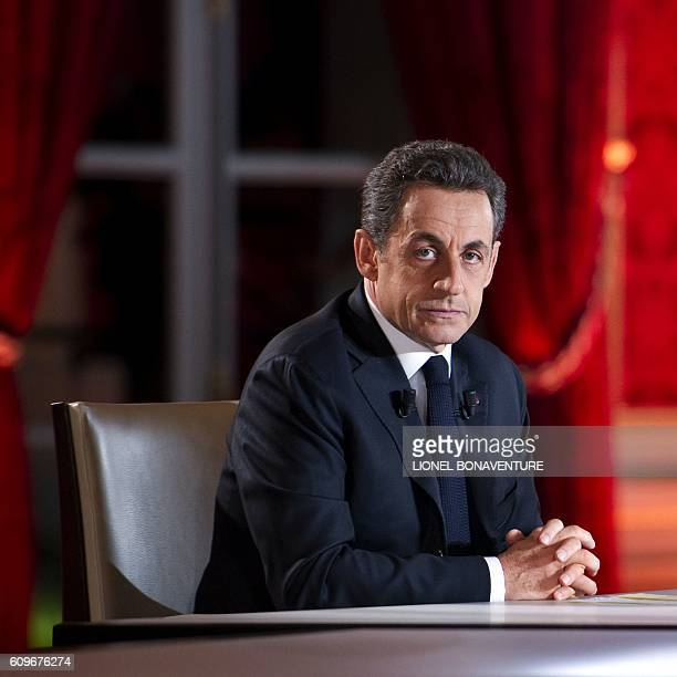 France's President Nicolas Sarkozy waits for the start of the one hourlong television interview with journalists Claire Chazal and Laurent Delahousse...