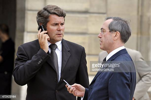 France's president Nicolas Sarkozy's communication adviser Franck Louvrier and Elysee's General Secretary Claude Gueant talk before leaving the...