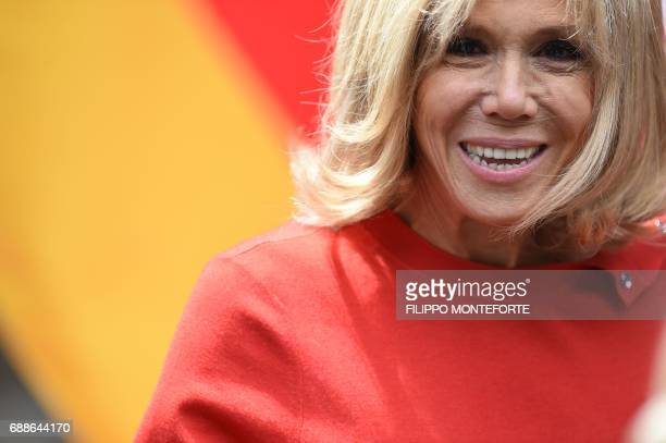 TOPSHOT France's president wife Brigitte Macron leaves the Hotel San Domenico for an official visit in Catania on the sidelines of the Heads of State...