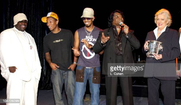 Frances Preston BMI CEO presents James Brown with the 2002 ICON award as Rodney Jerkins Pharrell Williams and Dallas Austin look on