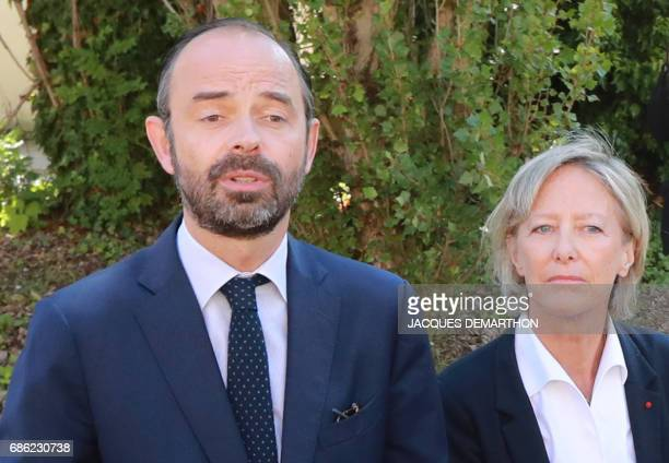 France's Prime Minister Edouard Philippe flanked by French Junior Minister in Charge of Disabled people Sophie Cluzel speaks to the press as he...