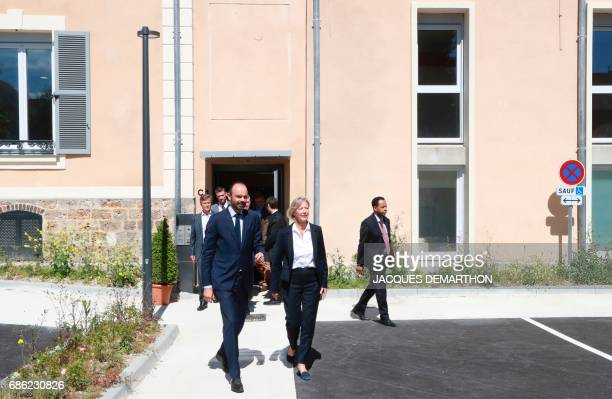 France's Prime Minister Edouard Philippe flanked by French Junior Minister in Charge of Disabled people Sophie Cluzel visits the Simon de Cyrene...