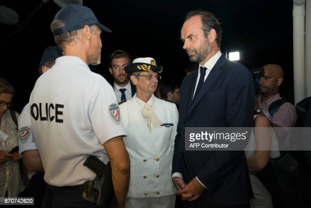 France's Prime Minister Edouard Philippe flanked by the French prefete of Saint Martin and Saint Bartelemy Anne Laubies meets policemen as he arrives...