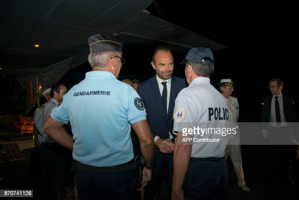 France's Prime Minister Edouard Philippe shakes hands with police forces at the airport as he arrives on the French Caribbean Island of SaintMartin...